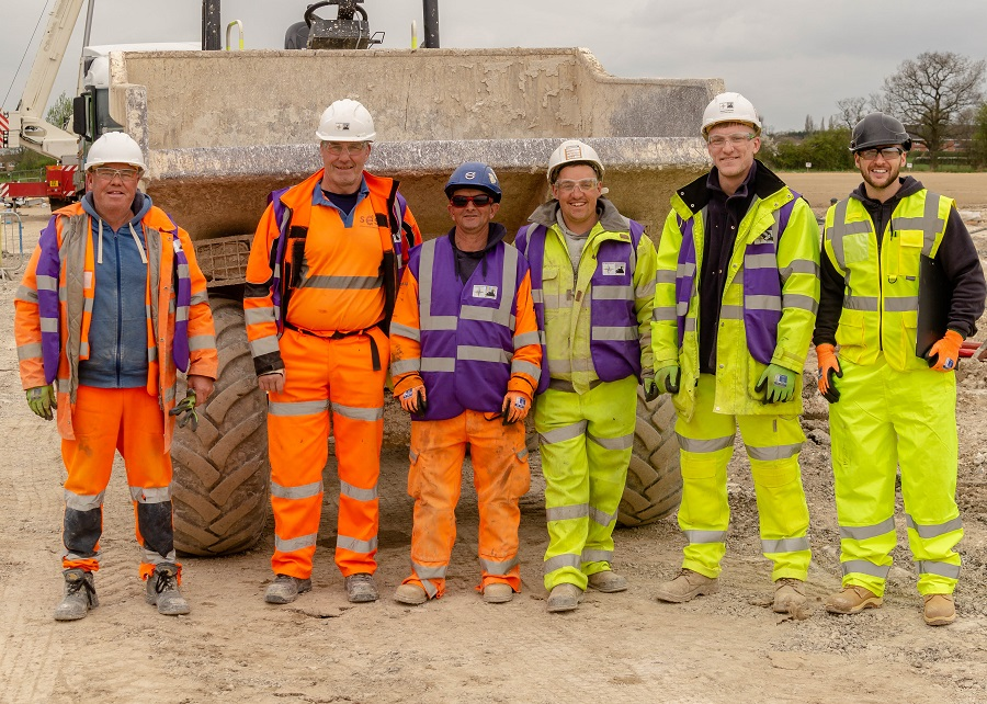 image shows a group of construction workers
