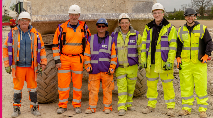 photo shows construction workers who have completed health and safety training courses and are happy