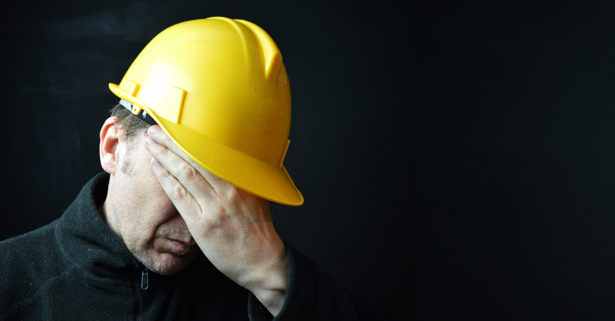 picture shows a construction worker looking sad to illustrate a blog by Essential Site Skills on mental health concerns in the construction industry