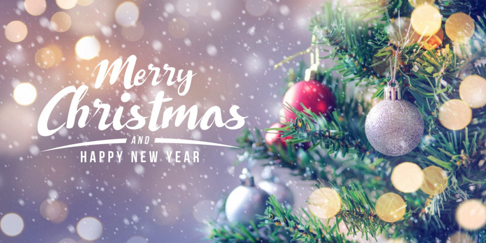 """Christmas tree and the words """"Merry Christmas and a Happy New Year"""""""