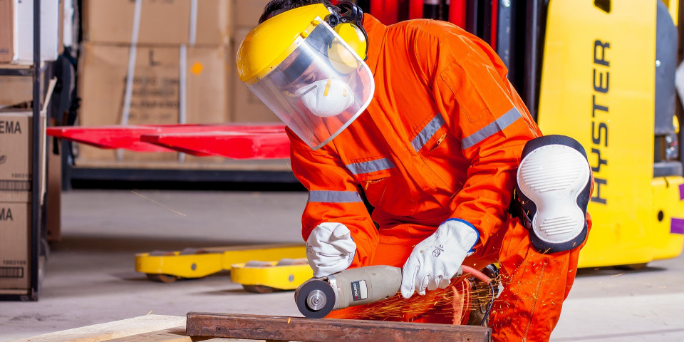 image shows a worker wearing PPE which is considered important to workplace safety